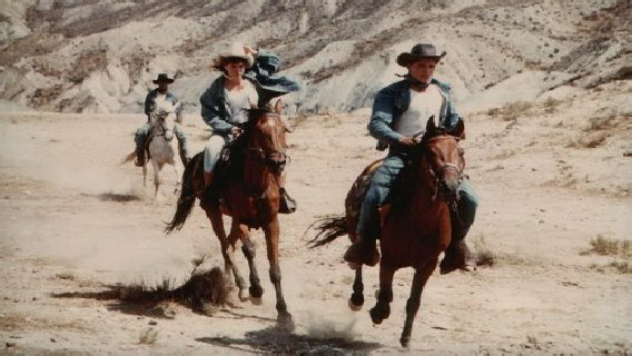 Cowboys riding in Mini Hollywood in Spanish desert filmed by Sussex Lighting Cameraman Mark Snashall